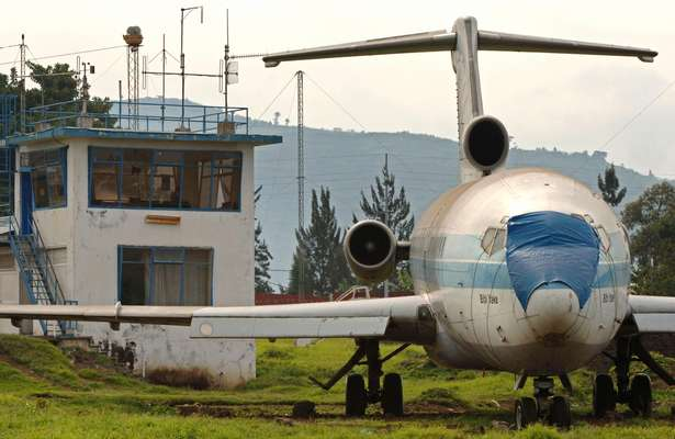 Abandoned plane and tower at Goma airport