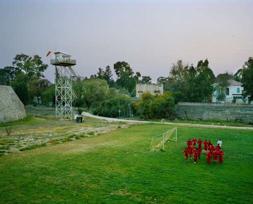 Disused UN watchtower overlooks the city's former moat, serving as a pitch for a Northern Cypriot football team