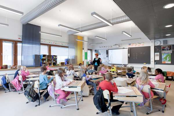 Flip-top beech and steel desks from Finnish company Martela are used in the classrooms