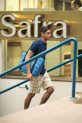 Polo shirt by Scye Basics, shorts by United Arrows, bag by Porter