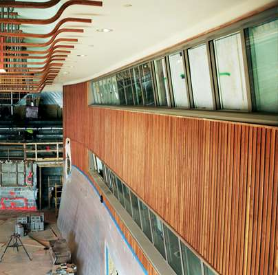 Sculptural ceiling and wood panelling