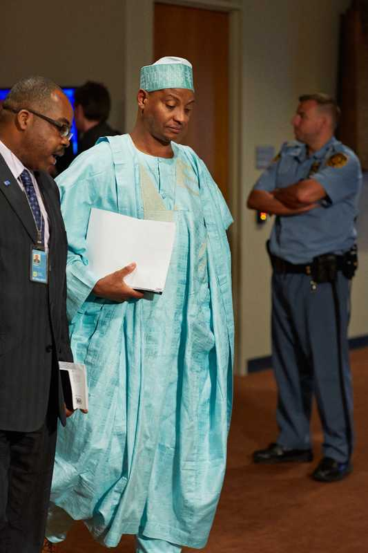 The Nigerian delegation leaves the chamber after a debate