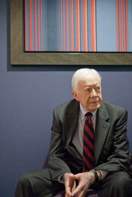 Former president Jimmy Carter takes a moment to reflect during his visit to London