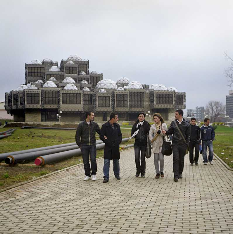 Students with Pristina's library in the background