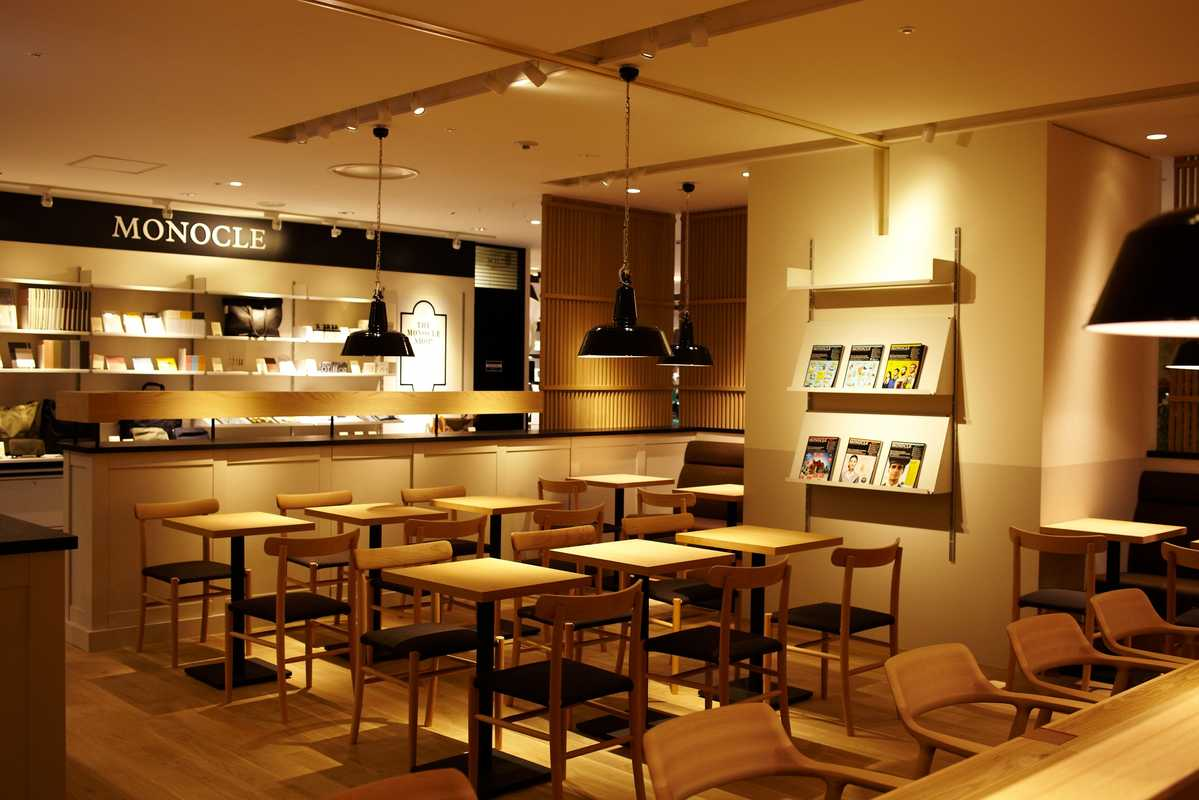 The Monocle Café and Shop interior contains hand-picked furnishings including beech and birch chairs designed by Naoto Fukasawa and Jasper Morrison for Hiroshima-based Maruni Wood Industry and Bolichwerke lampshades