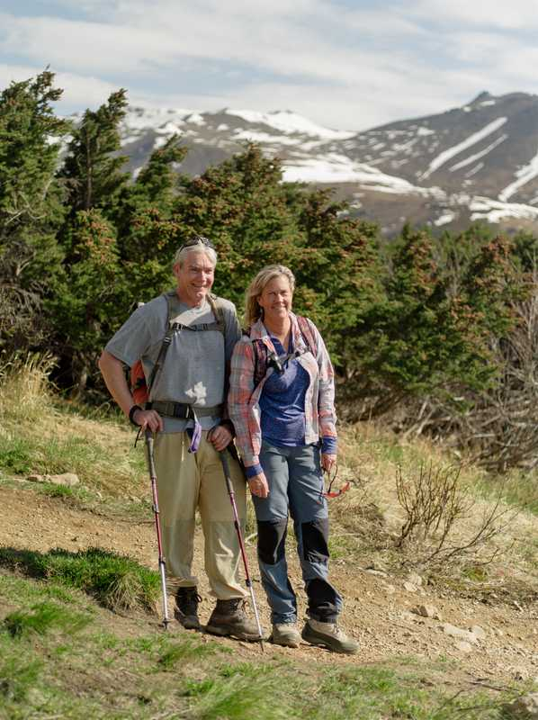 Pat Thompson and Holly Macleod hiking on Flattop Mountain