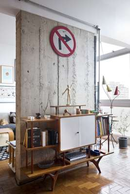 Refurbishment has revealed the building's concrete structure in their apartment