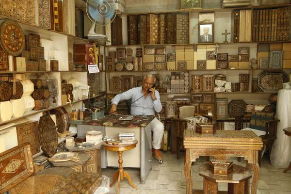 Craftsmen wait for the return of tourists