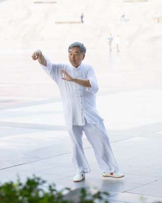 Resident practising tai chi in the People's Square