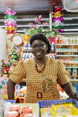 Shop owner at Cayenne's fish market