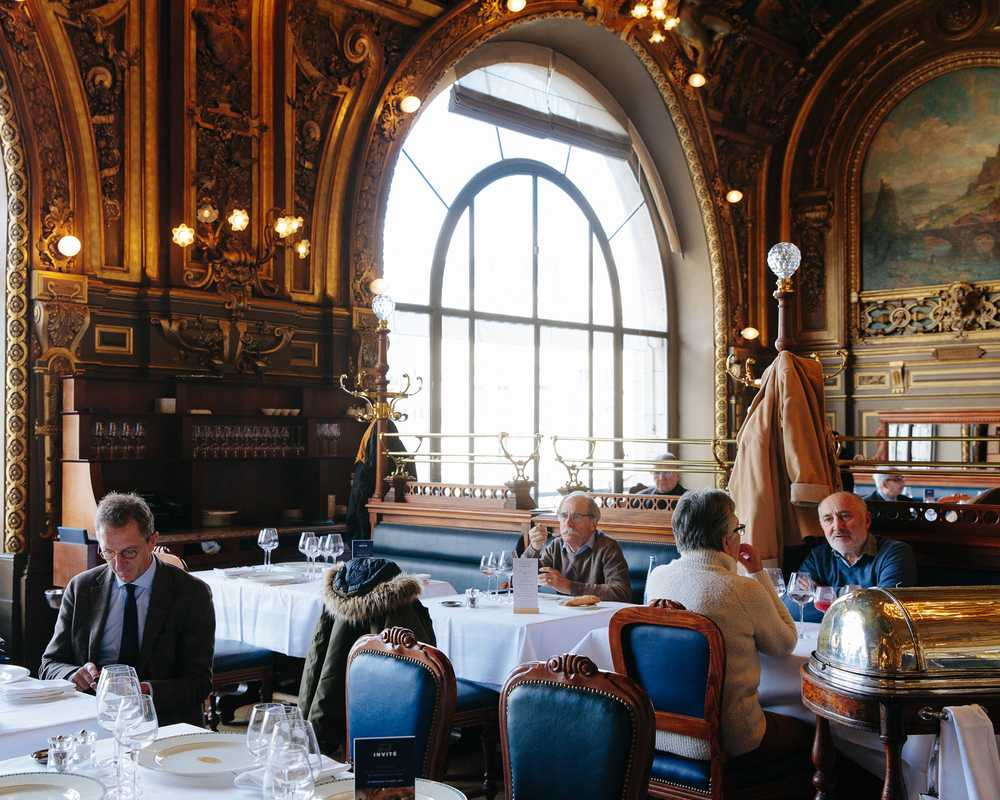 The dining room at Le Train Bleu was decorated by 12 artists