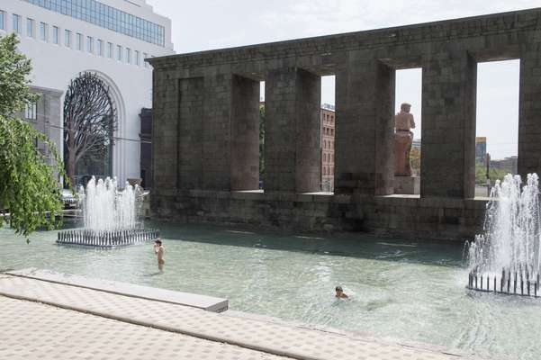 Cooling off in a pool beside the monument of Stepan Shahumyan