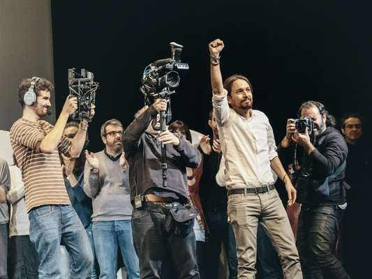 Pablo Iglesia celebrates being voted Podemos party leader at a rally