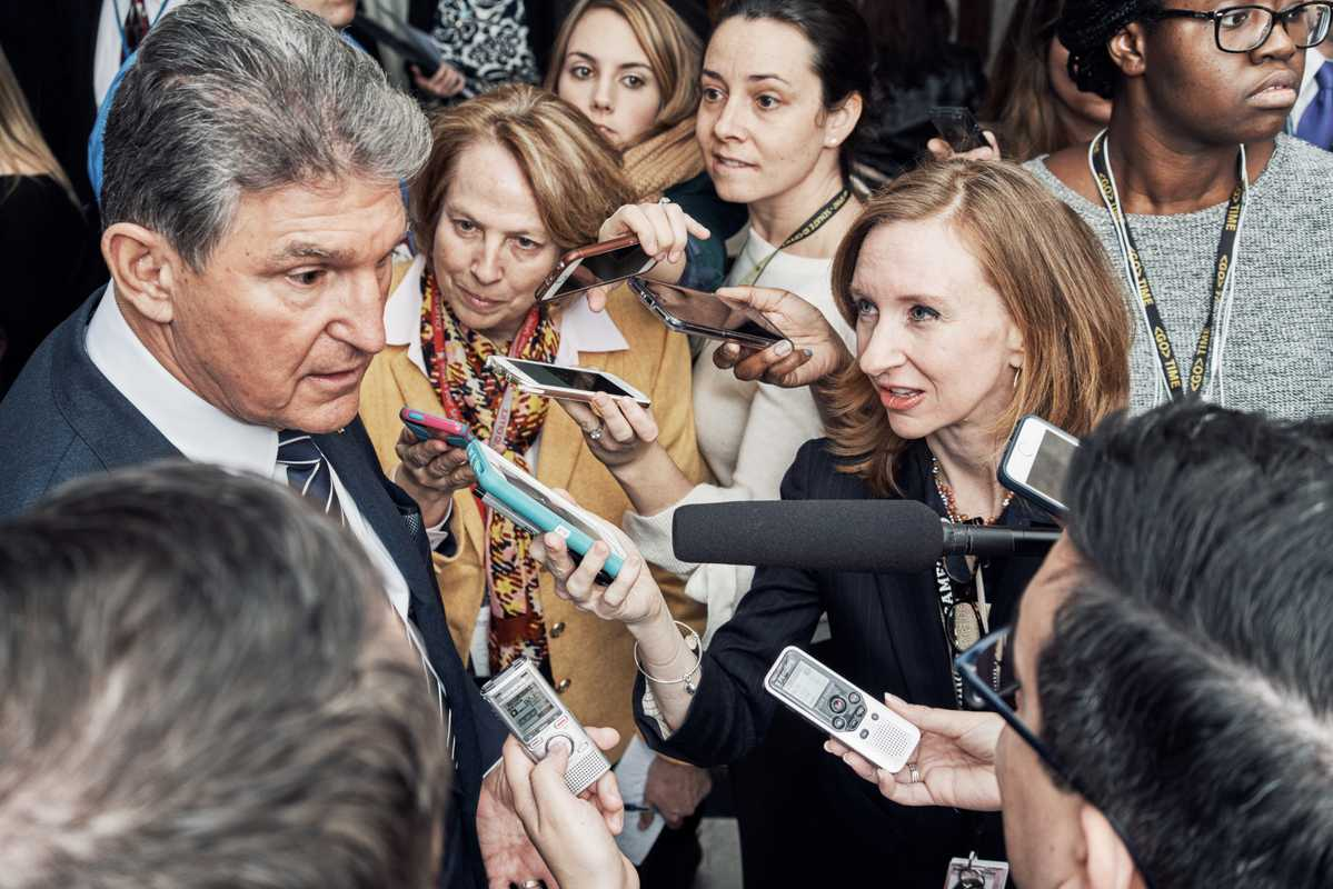 Political correspondent Lisa Desjardins interviewing Democratic senator Joe Manchin outside the US Senate Chamber