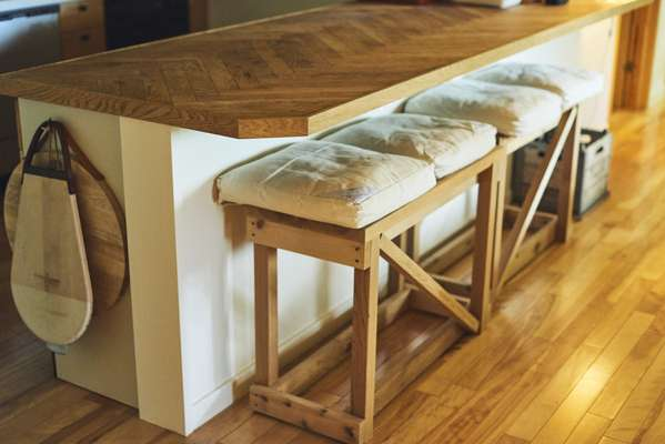 Wooden counter with benches by Takanori Ota of OFC