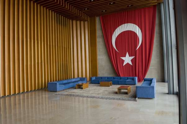 A flag of the Republic of Turkey adorns one end of the foyer