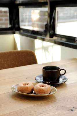 Doughnuts and coffee on Truck crockery