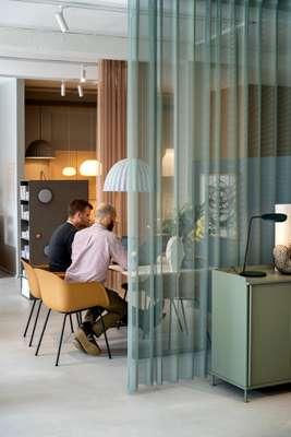 Muuto employees using the showroom