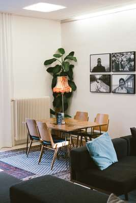 The lobby area of Vienna's eclectic Magdas Hotel, with walls adorned with photography sourced from a nearby school