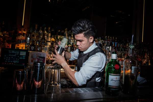 Unusual barman attire: a bulletproof vest