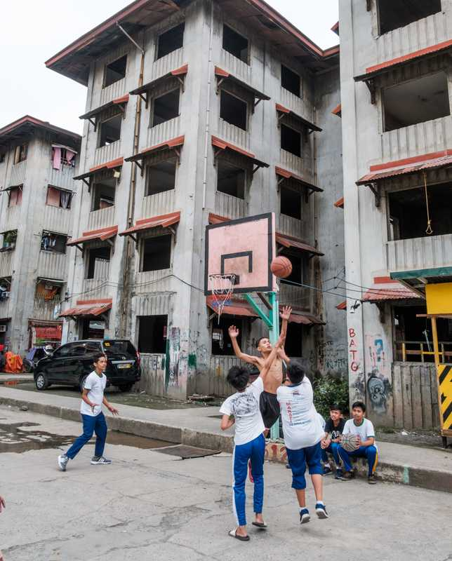 School children playing next  to unfinished housing projects in Makati City