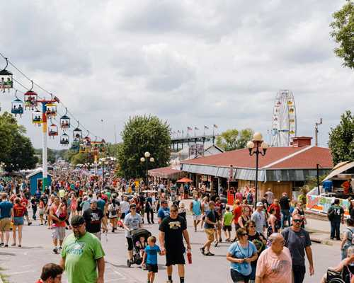 Iowans strolling the fair's main drag