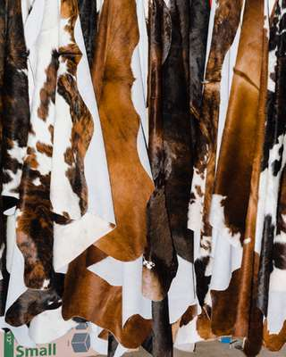 Cowhides for sale at the fair