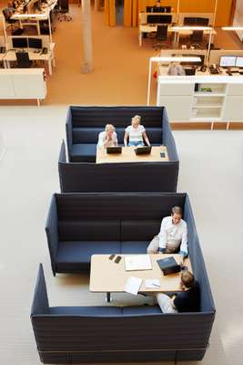 Staff meet in comfort on Vitra high back sofas designed by Ronan and Erwan Bouroullec