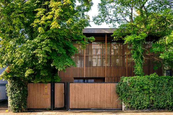 Japan-inspired wooden louvres at the front of the house