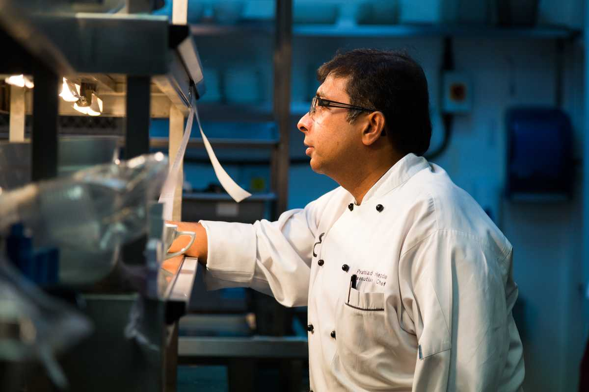 Executive chef Prahlad Hegde monitors service