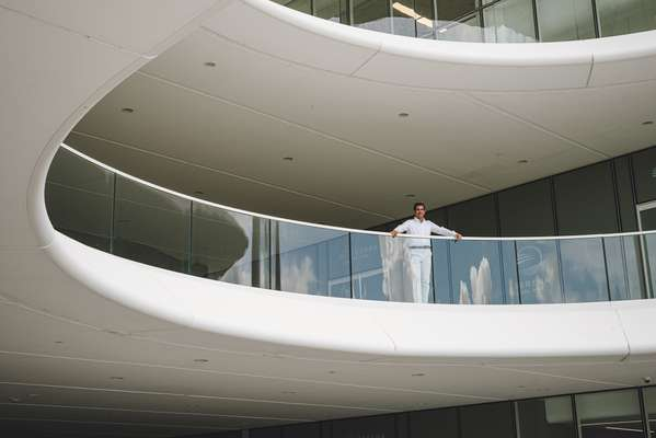 Daniel Haime surveying Serena Del Mar from the balcony of the Los Andes University campus, designed by Brandon Haw