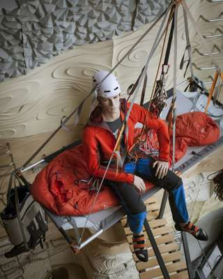 Mannequin greets climbers at  the top of the climbing wall