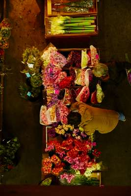 Buyers looking through the flowers on offer