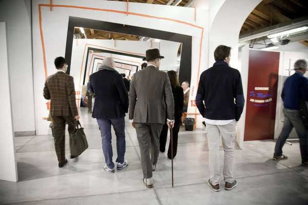 Visitors to the 83rd edition of Pitti Uomo