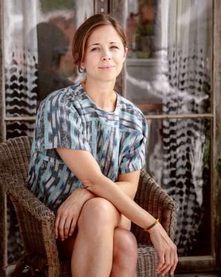 Harper Poe of Proud Mary Textiles on the piazza of her Charleston home