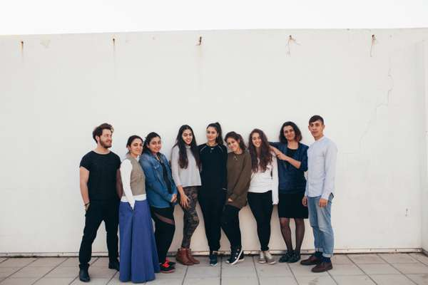 Students and staff at Alba's fashion school