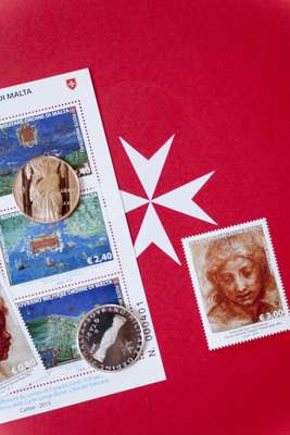 Coins and stamps produced by the Order