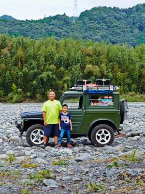 Toshihiko Muramatsu and son Yuha with their DIY sleeper Jimny