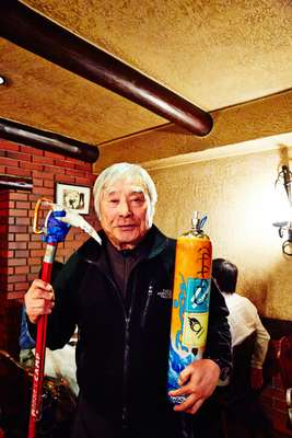 Miura with his oxygen tank and ice axe