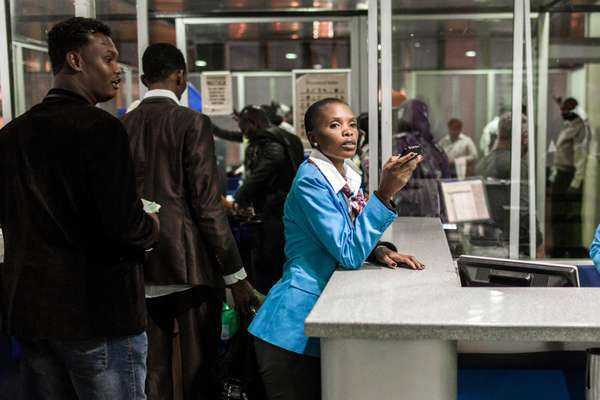 A Nairobi airport employee overseeing the passengers for flights to Somalia