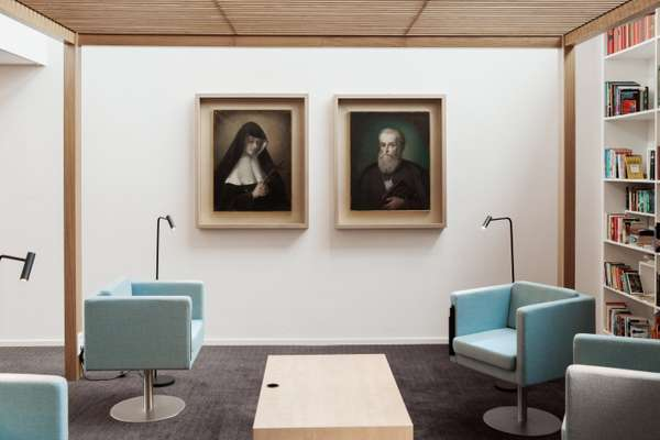 Portraits of the two founders of the school hanging in the library