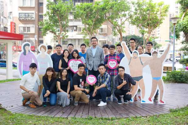 Jay Lin (centre),  co-director of Taiwan International Queer Film Festival, with staff in Taipei's Da'an district