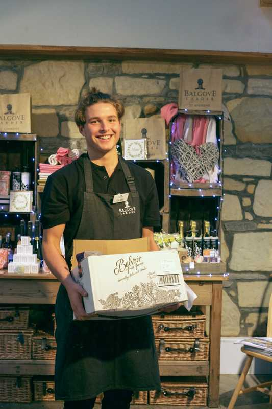Staff member Liam at work in the Balgove Larder café