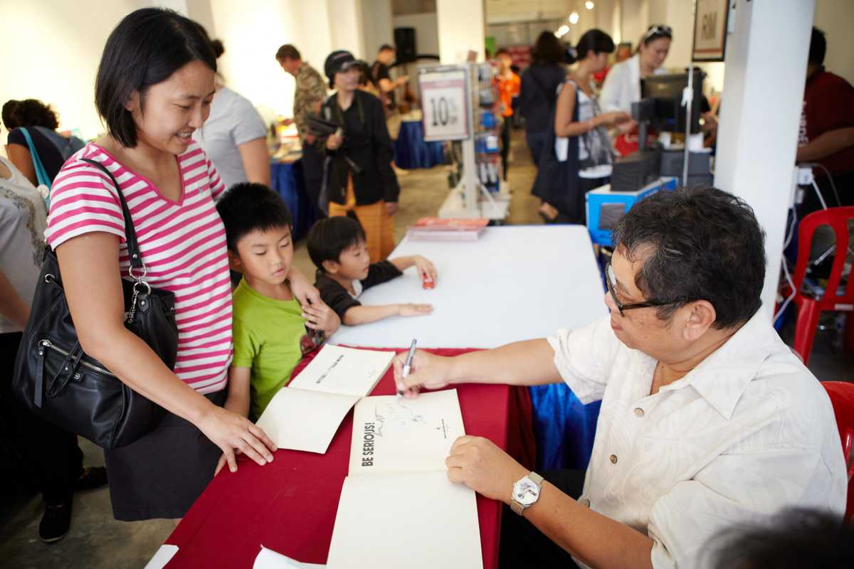 Lat chats with readers and signs books at the George Town Literary Festival in Penang