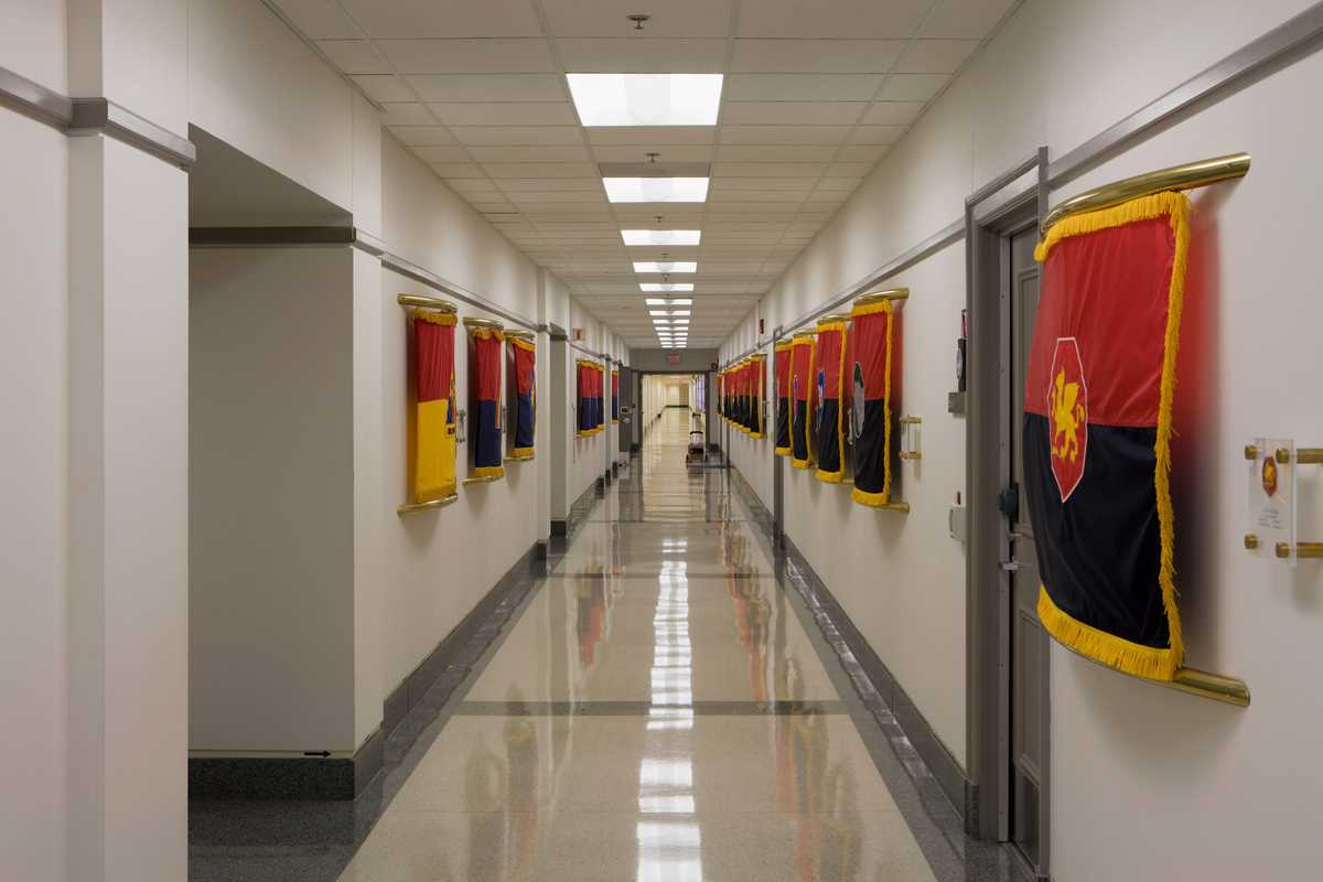 A Pentagon corridor displaying the flags of the National Guard