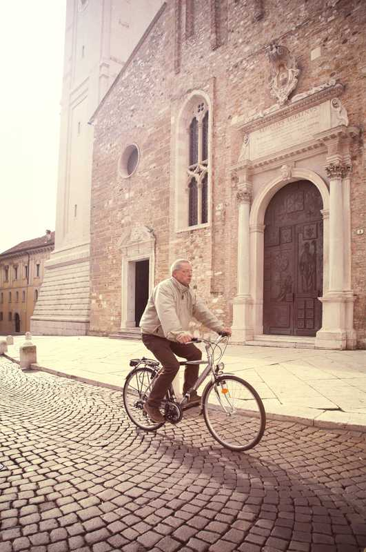Cyclist outside the cathedral
