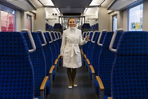 An attendant shows off the German DB Inter Regio-train by Alstom