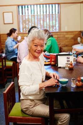 Junko Shimada seated at her usual table
