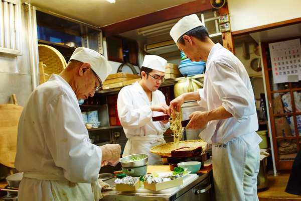 Chefs work at a low table