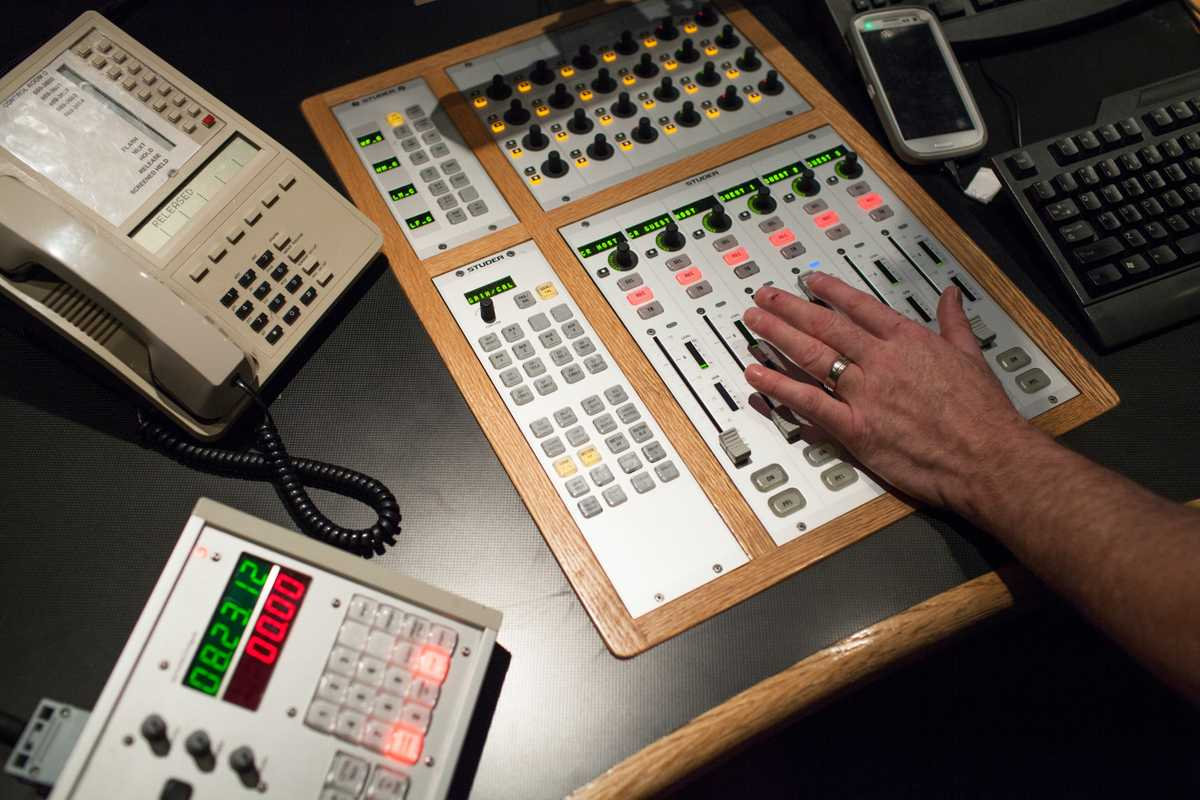 Fingers at the ready in the radio control room